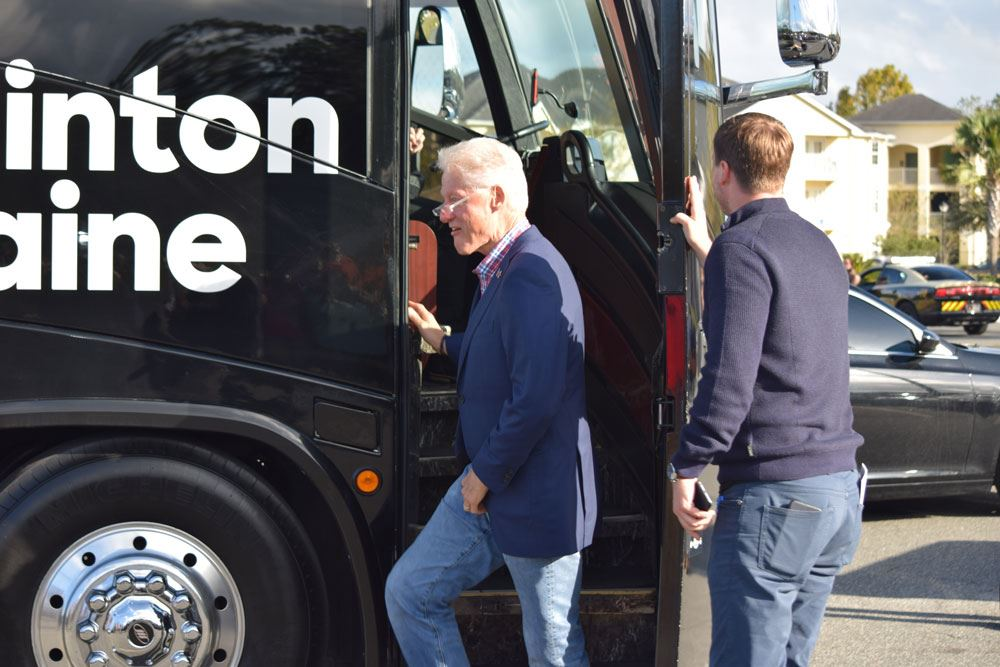 Former President Bill Clinton exits the campaign bus in Palatka.